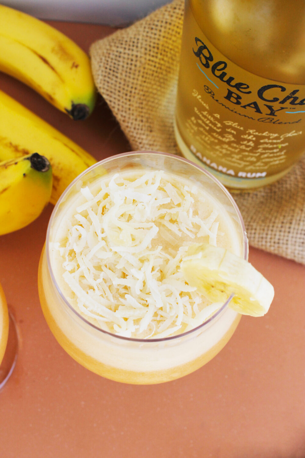 Looking for a stellar warm weather cocktail recipe? This Banana Colada from lifestyle blogger Carly of Lipgloss & Crayons will hit the spot!