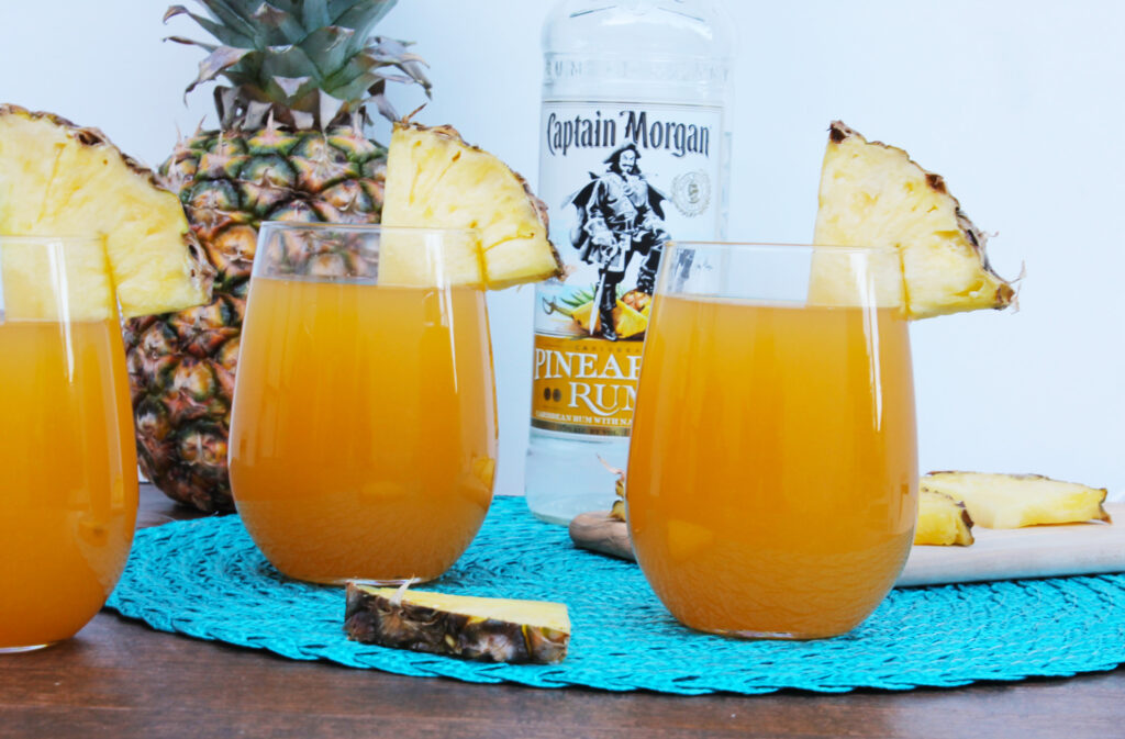 This pineapple mango rum punch is the perfect summer cocktail recipe ...