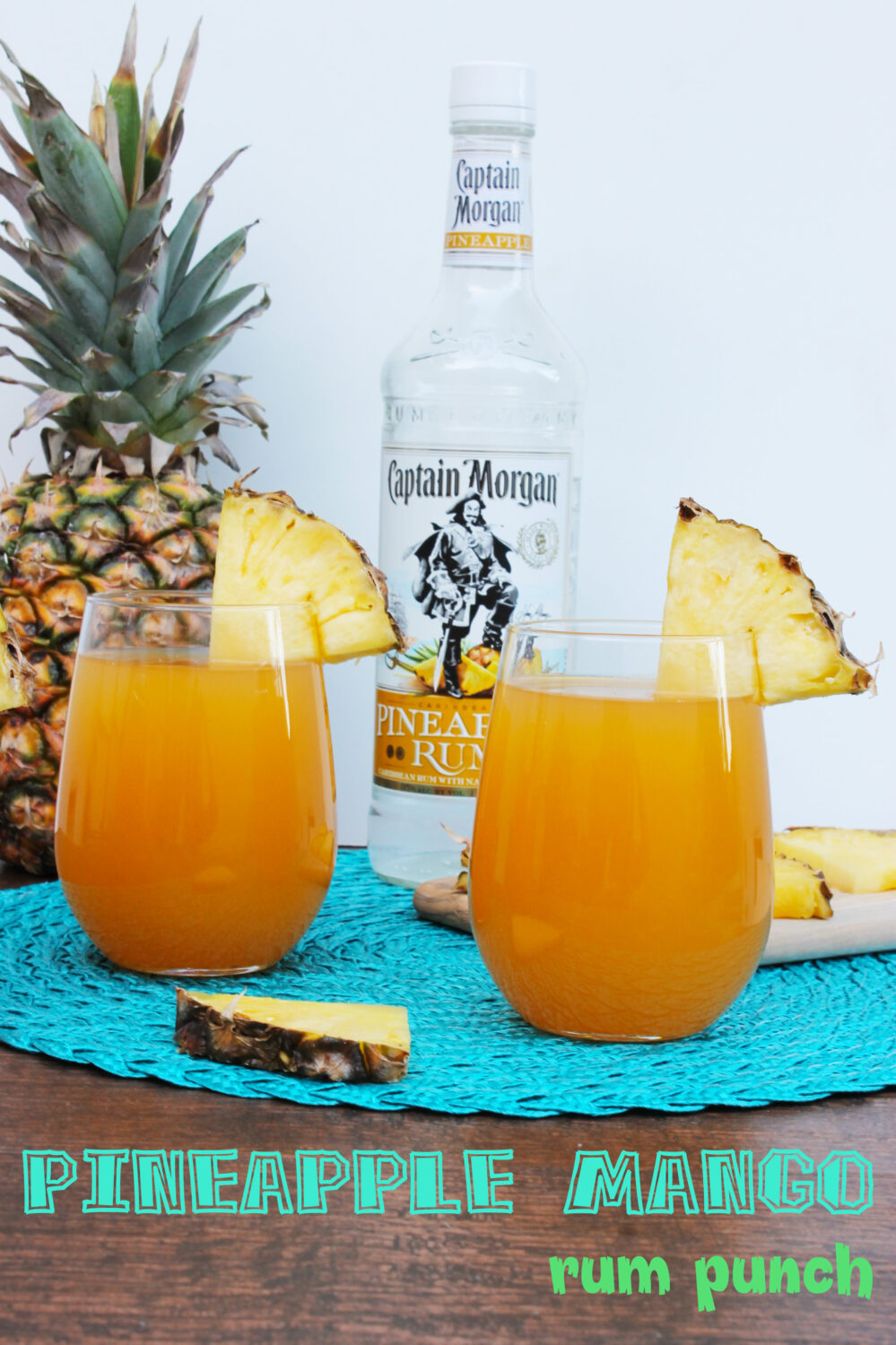 Lifestyle blogger Carly from Lipgloss and Crayons features this pineapple mango rum punch is the perfect summer cocktail recipe! It's ideal for summer cook outs....plus that Captain Morgan's pineapple rum? DELISH!
