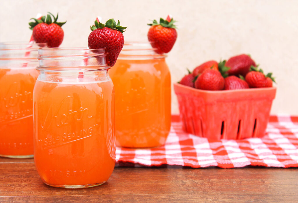 This spiked strawberry limeade is the perfect summer cocktail! It's the ideal drink to serve at bridal showers, BBQs, and summer brunch!
