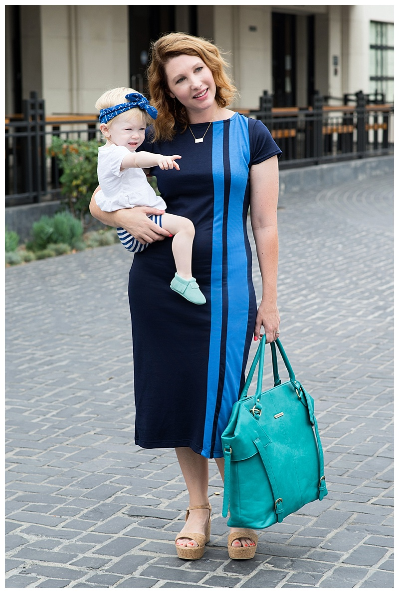 How adorable are these mommy and me blue dresses? The teal accents? Teal diaper bag, teal baby moccs, cuteness!