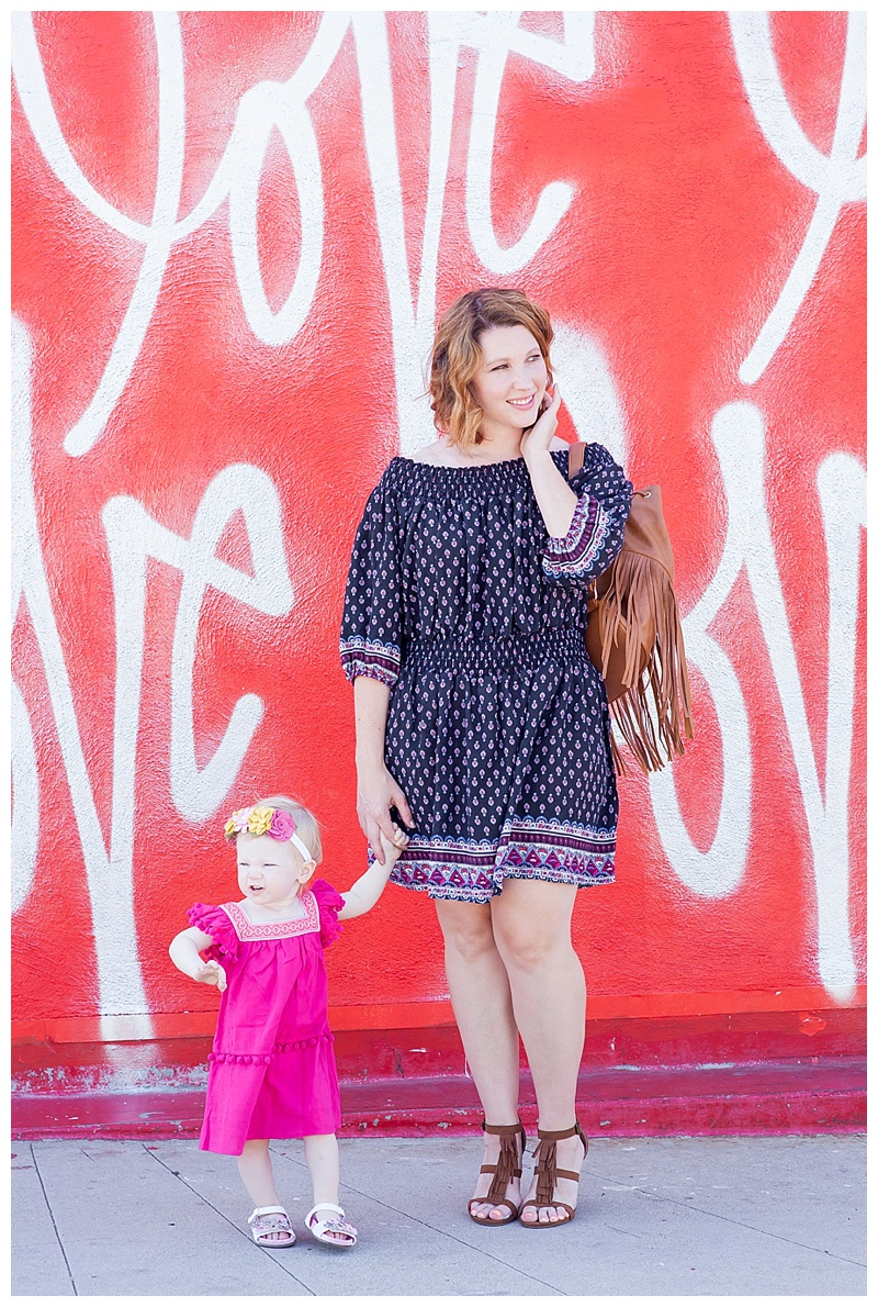 How cute is this mommy and me boho outfit? I love the fringe backpack and toddler floral wreath!