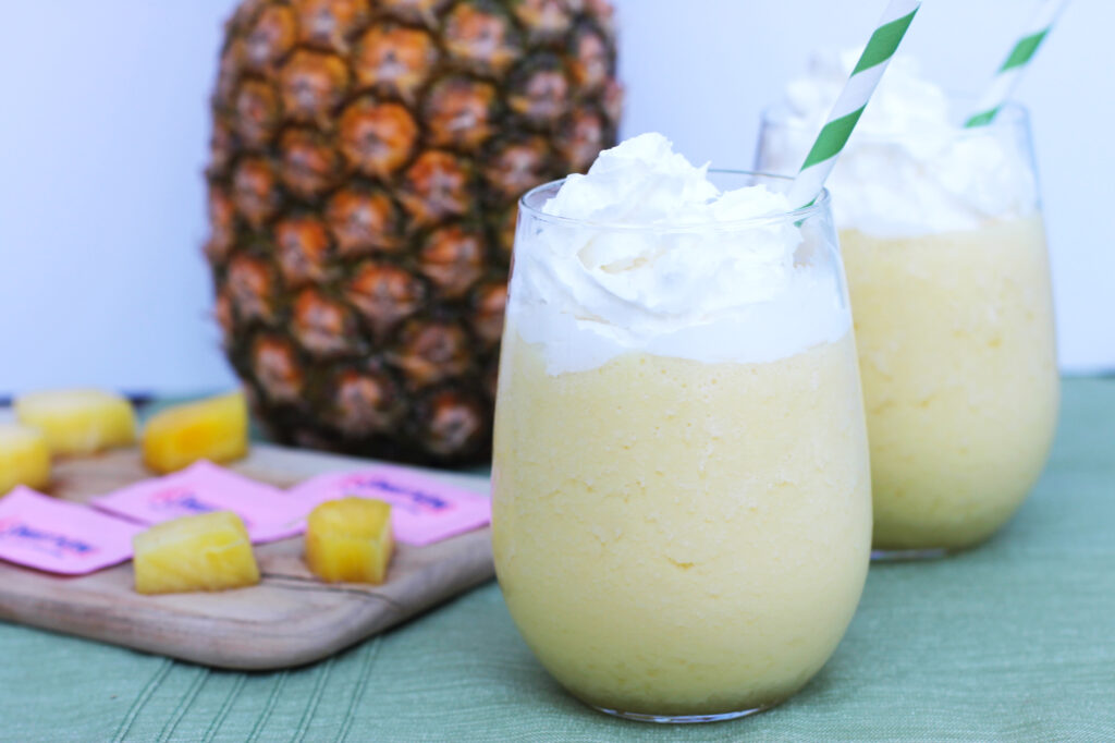 This Spiked Dole Whip cocktail recipe is perfect for warm summer nights! #donthesitaste #ad