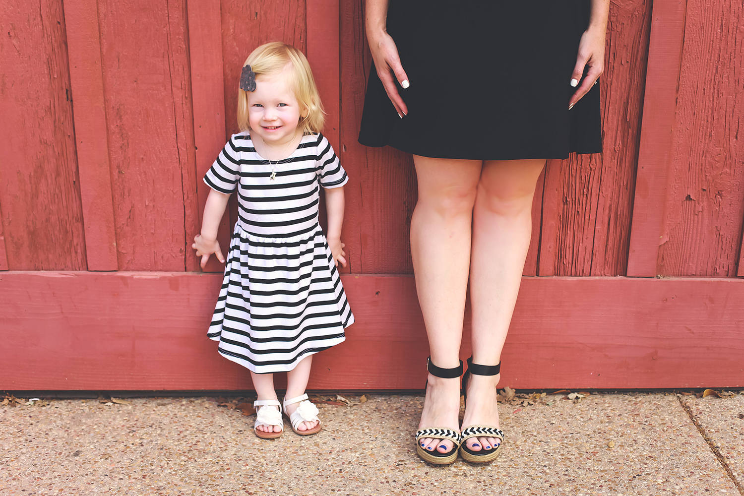 Looking for a great spring outfit? This black and white outfit is mommy and me wear at it's best! And those wedge sandals? Adorable!