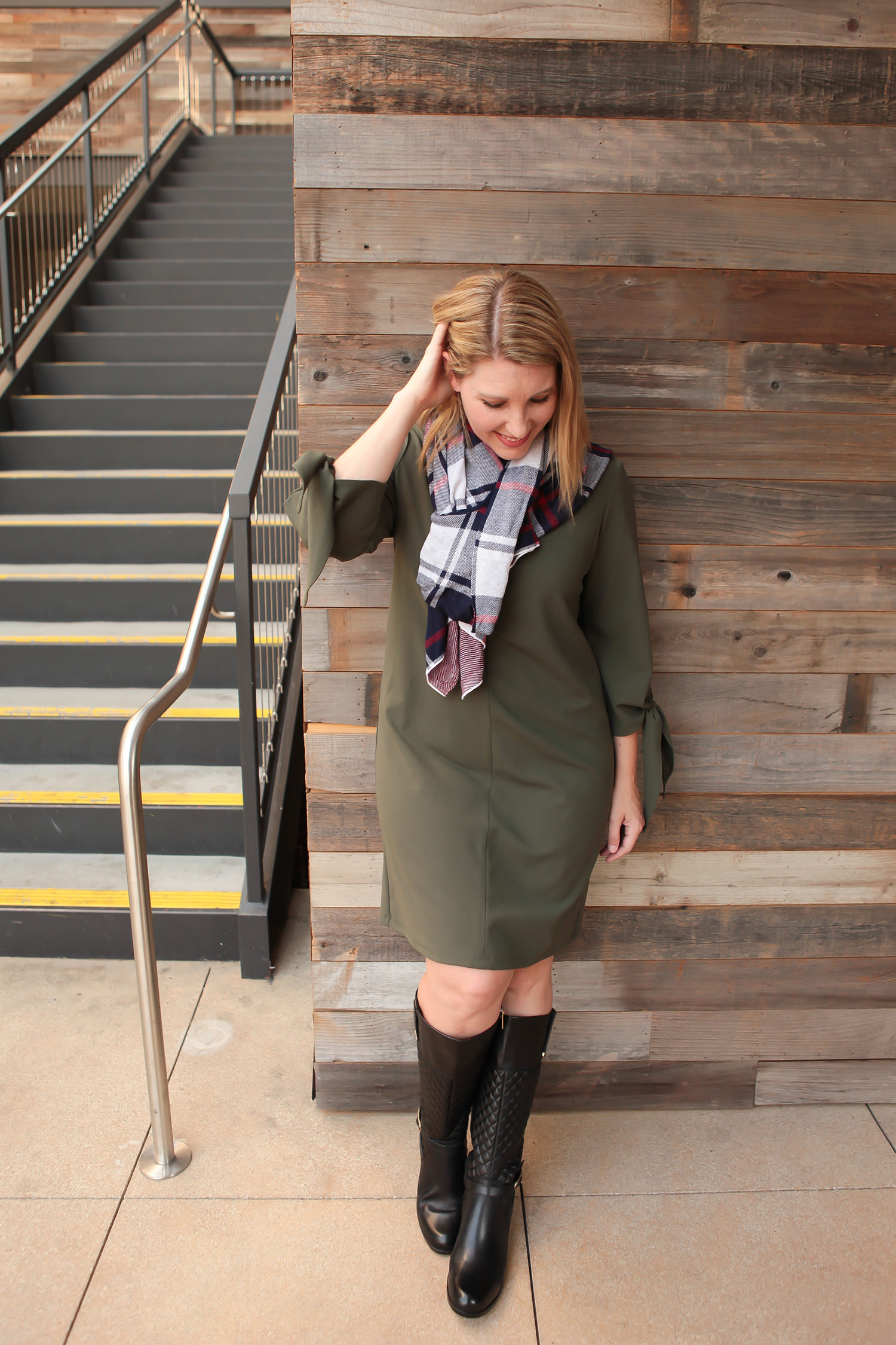 Looking for fall outfit inspiration? I love this olive shift dress with quilted boots and a plaid scarf!