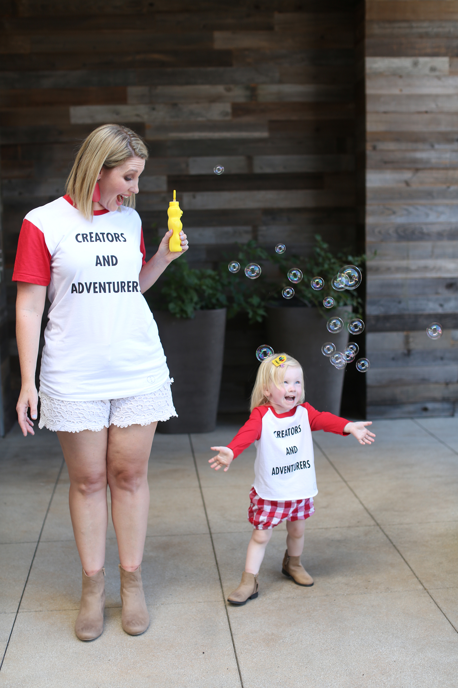 This mommy and me outfit is ADORABLE! I love the pops of red and fringe boots!