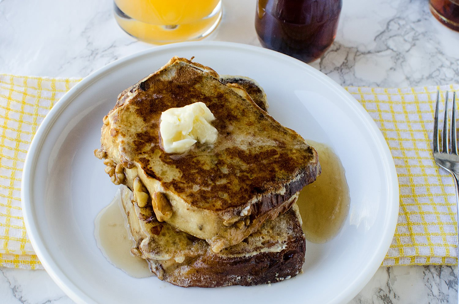 Breakfast about the only thing your kids will eat? Yup, us too. Lifestyle blogger Carly from Lipgloss & Crayons shares this banana bread french toast is delicious at any time of day!