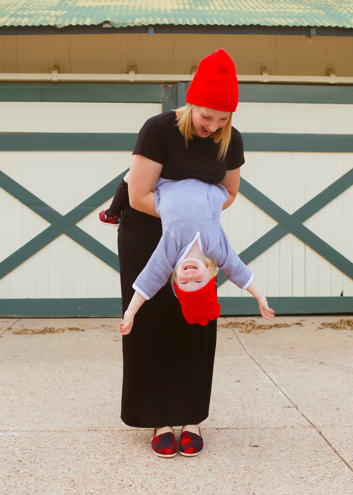 This fall mommy and me outfit is the cutest! Love the red beanies and mommy and me shoes!