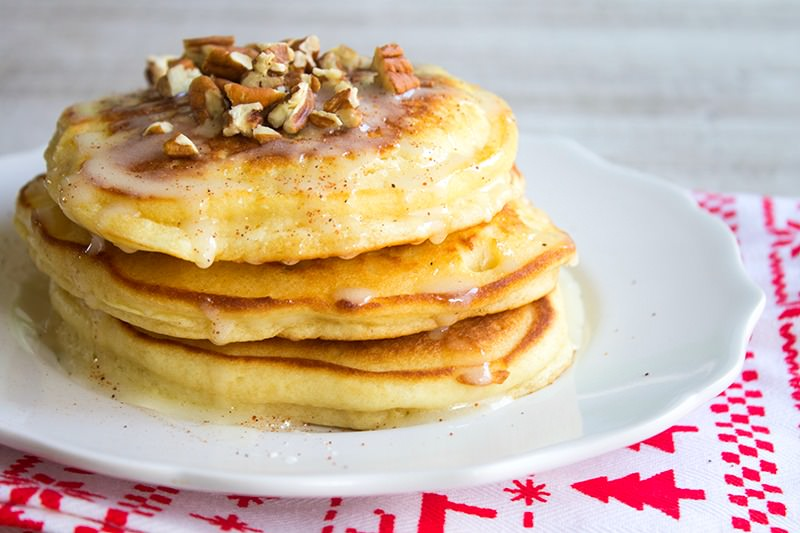 Eggnog Pancakes are the best way to start a winter morning! Filled with the flavors of the season, this comforting recipe is sure to be a hit at your house!