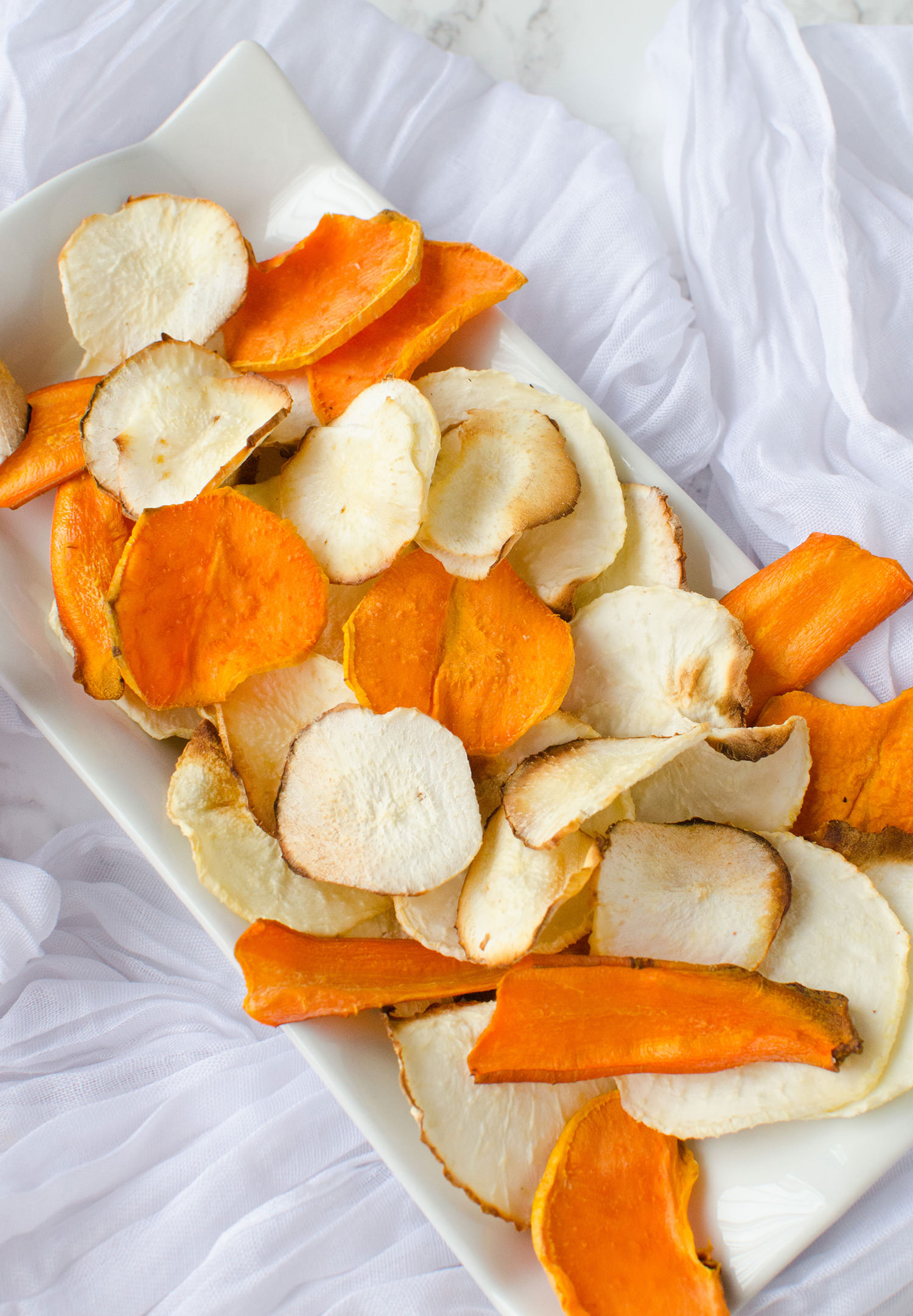 Looking for healthy family recipes? These homemade veggie chips are SUPER easy to make and taste delicious (bonus they're toddler meal friendly)!