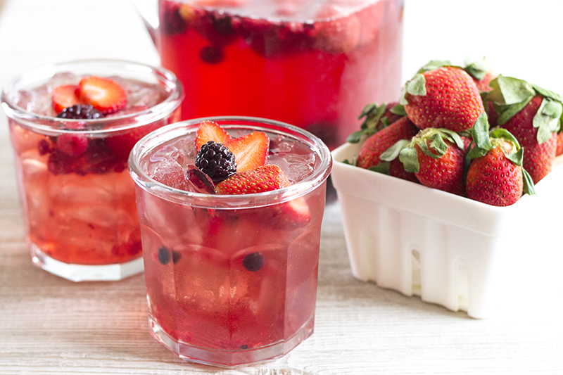 This Red Berry Pomegranate Punch is an easy-to-make cocktail that's perfect for serving a crowd!