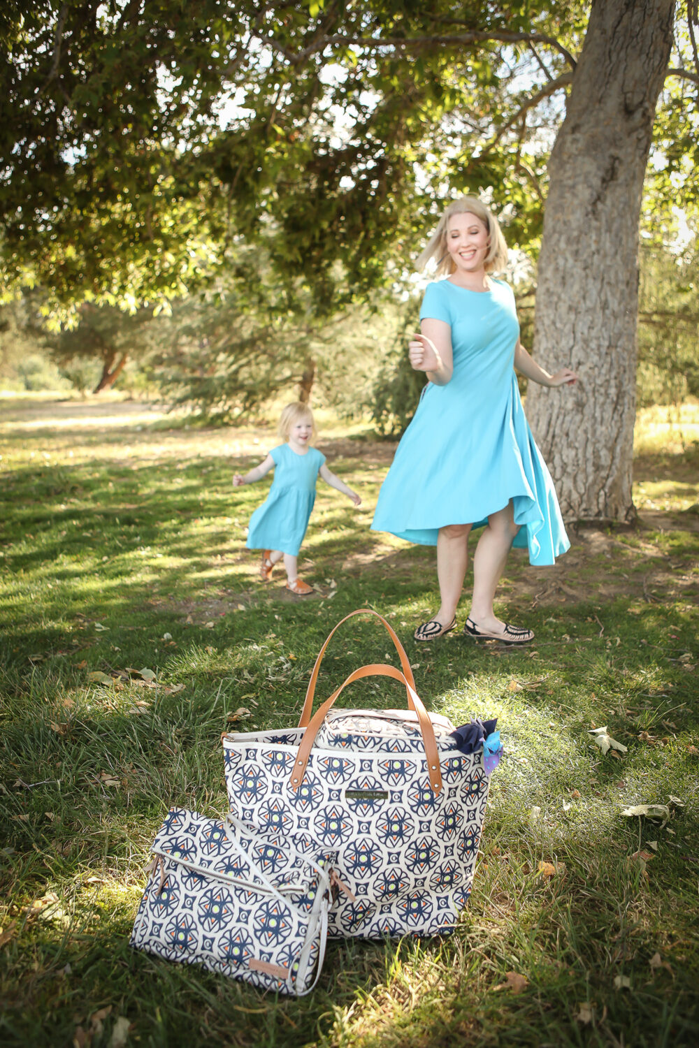 Mama Must Haves that Won't Cramp Your Style: Petunia Pickle Bottom Tote by lifestyle blogger Carly of Lipgloss and Crayons