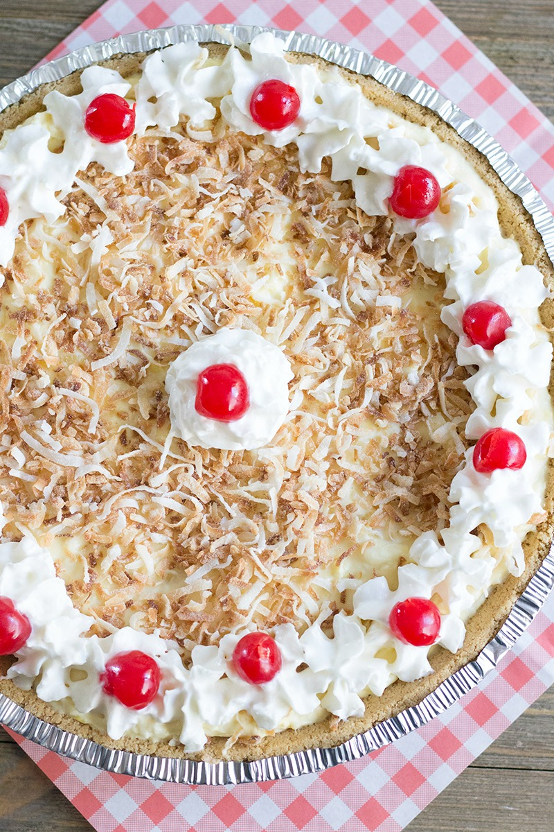 No Bake Pina Colada Pie is a fun & easy summer dessert that'll leave you feeling like you're on a tropical beach!