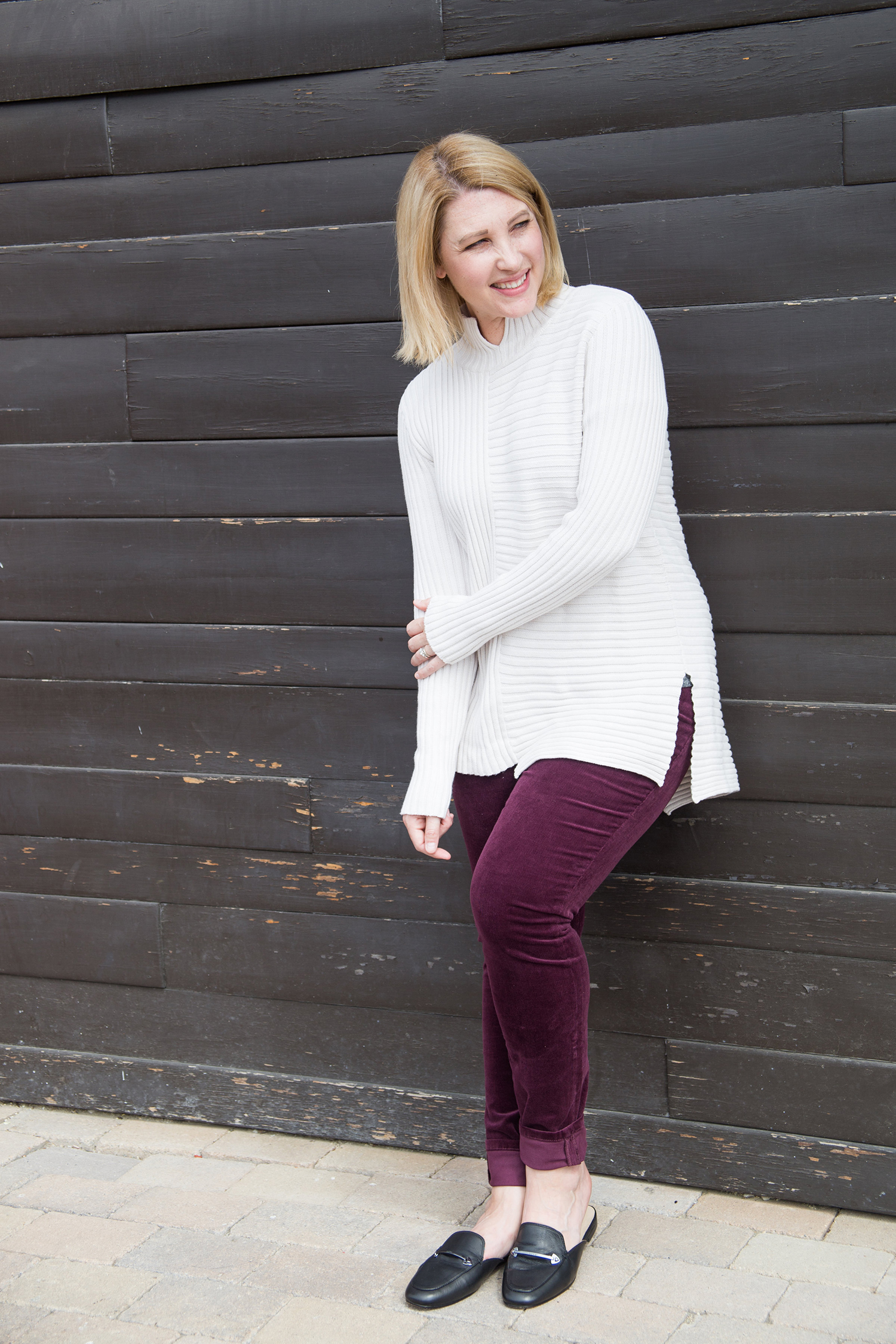 The best fall outfits for a pear shape body include these plum corduroy pants, this white sweater, and these loafer mules!