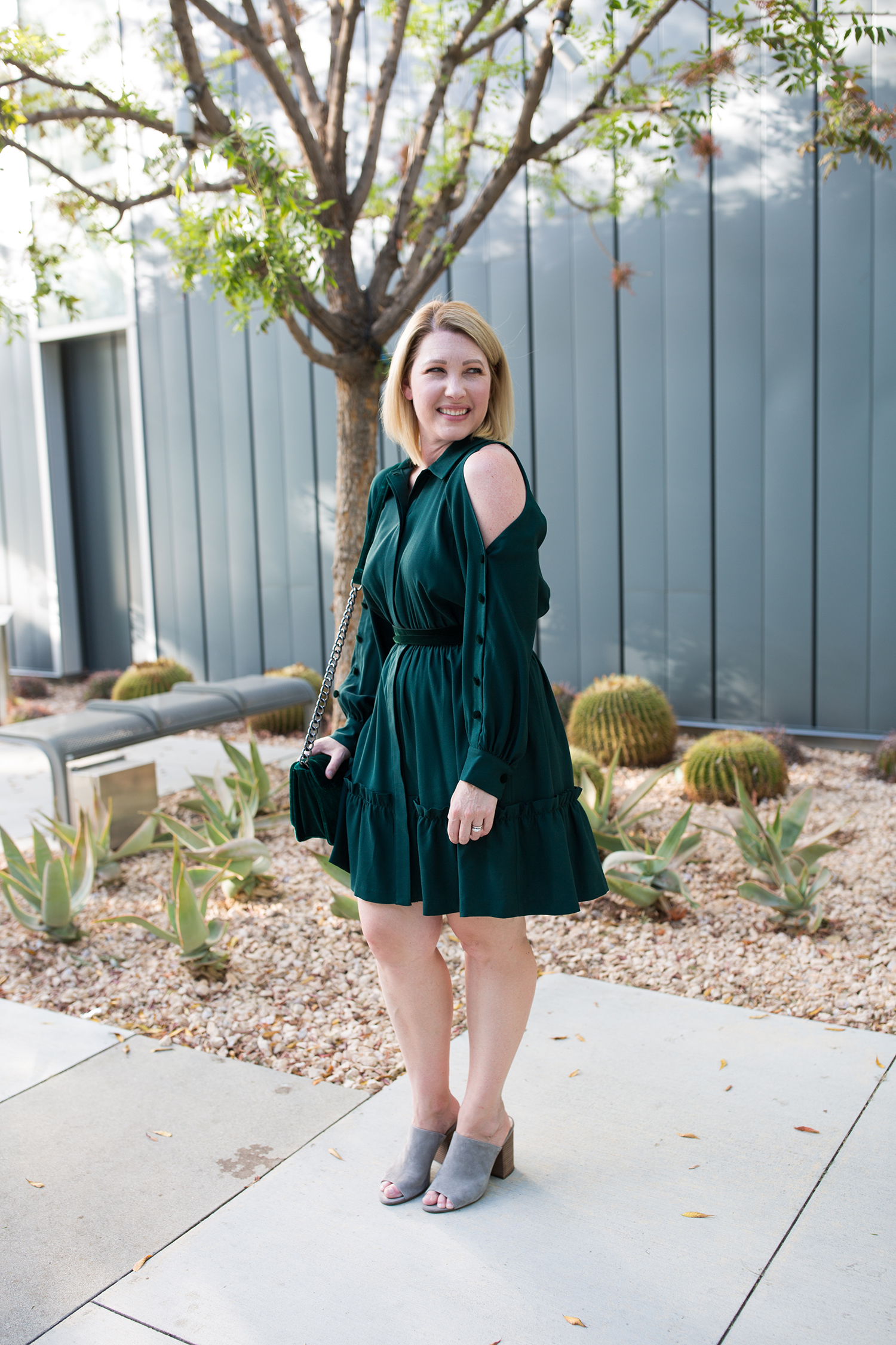 Searching for holiday dresses? I love this green cold shoulder dress for Christmas parties!