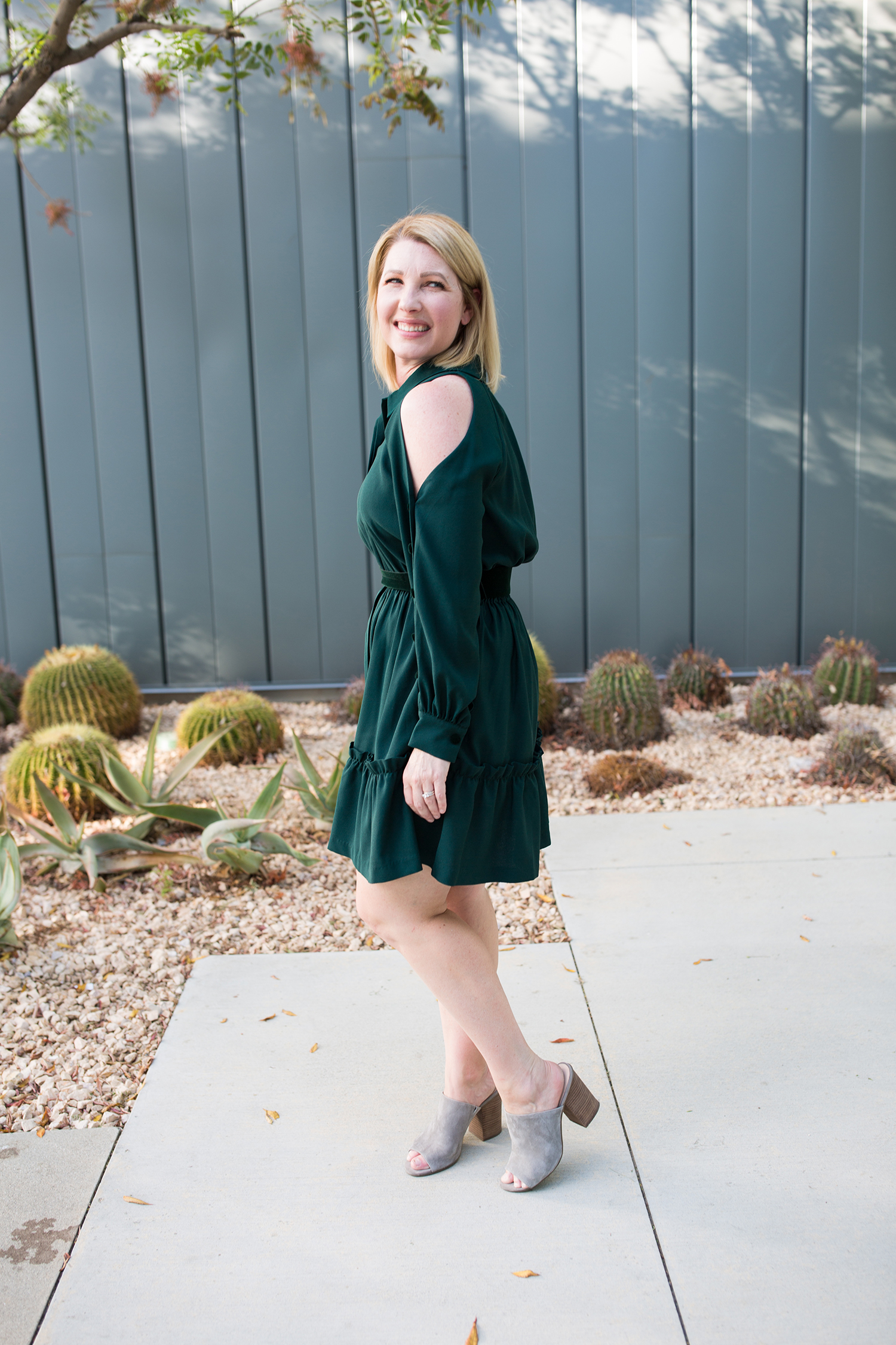 On the search for holiday dresses? This cold shoulder dress is flattering, easy to wear and the perfect holiday color!
