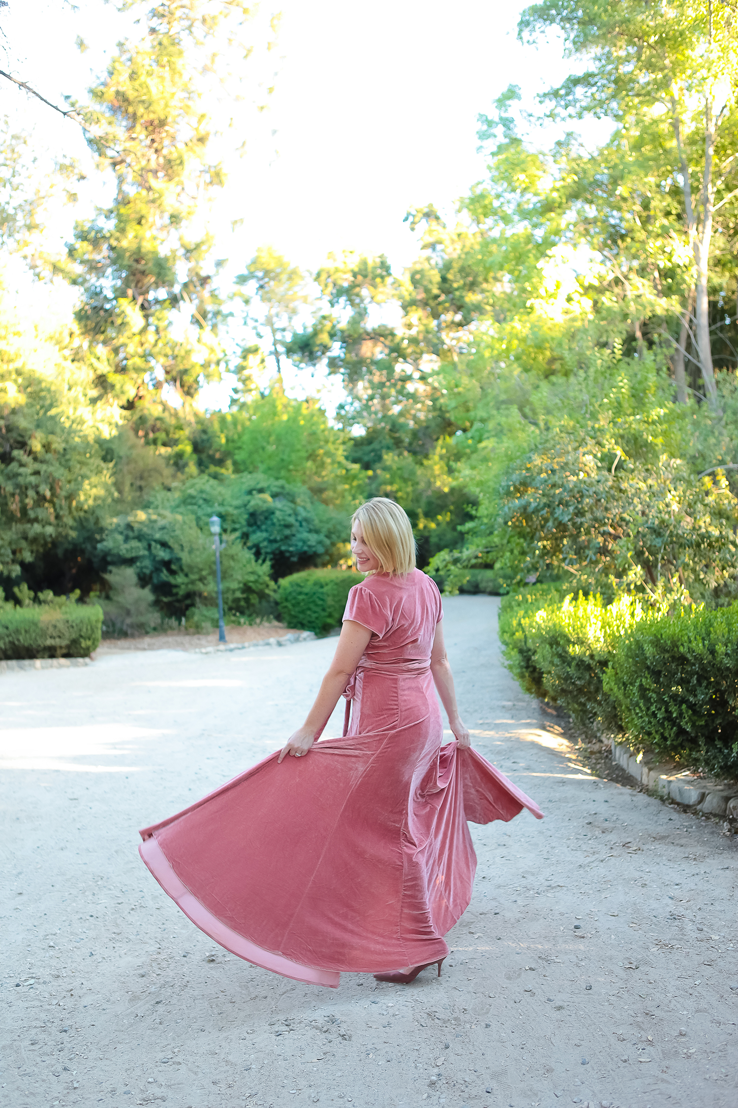 Looking for holiday dresses? This pink velvet dress fits like a dream and is the perfect Christmas party dress!