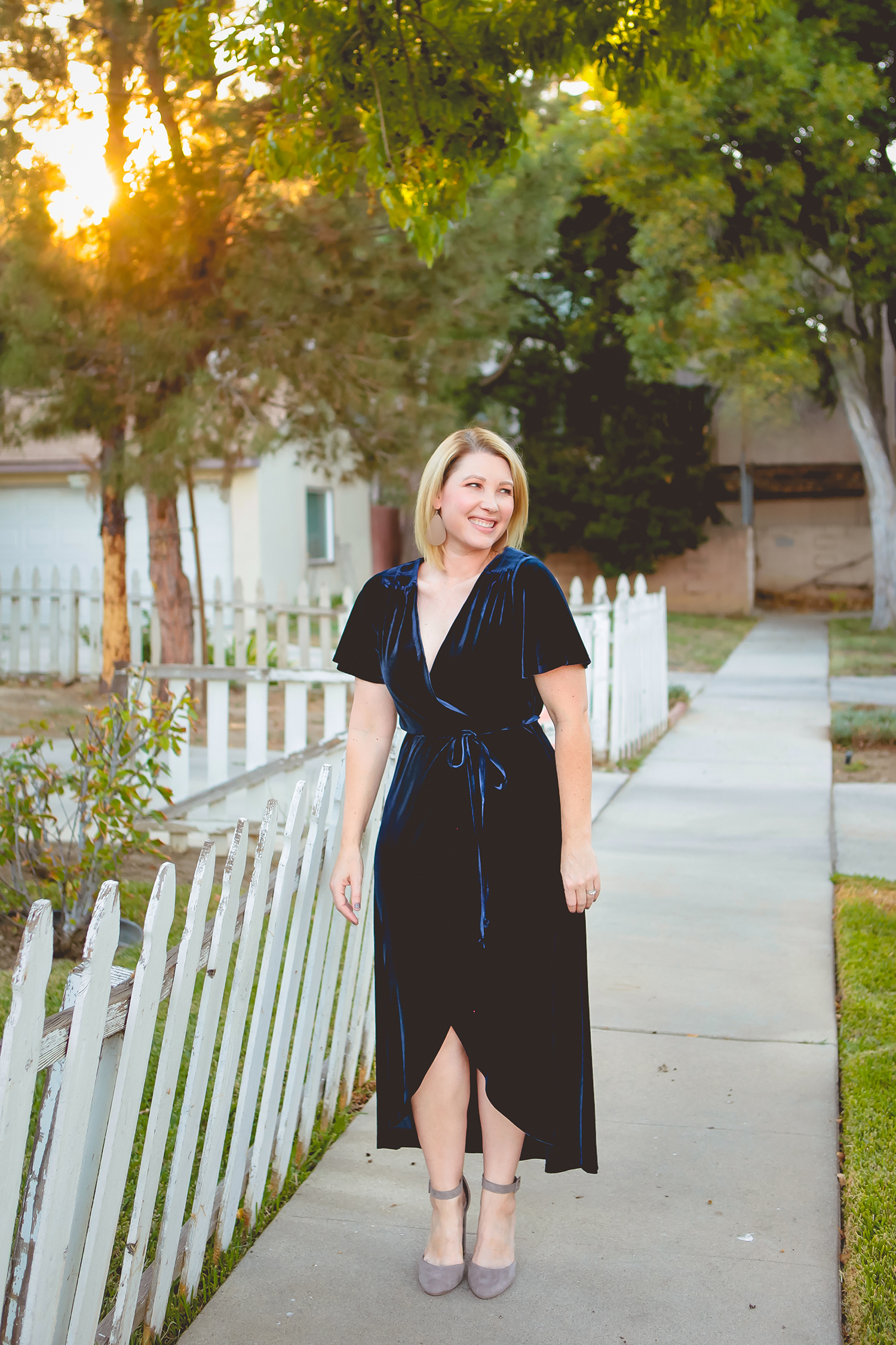 On the hunt for holiday dresses? This velvet wrap dress is the perfect piece to wear over and over again this holiday season!