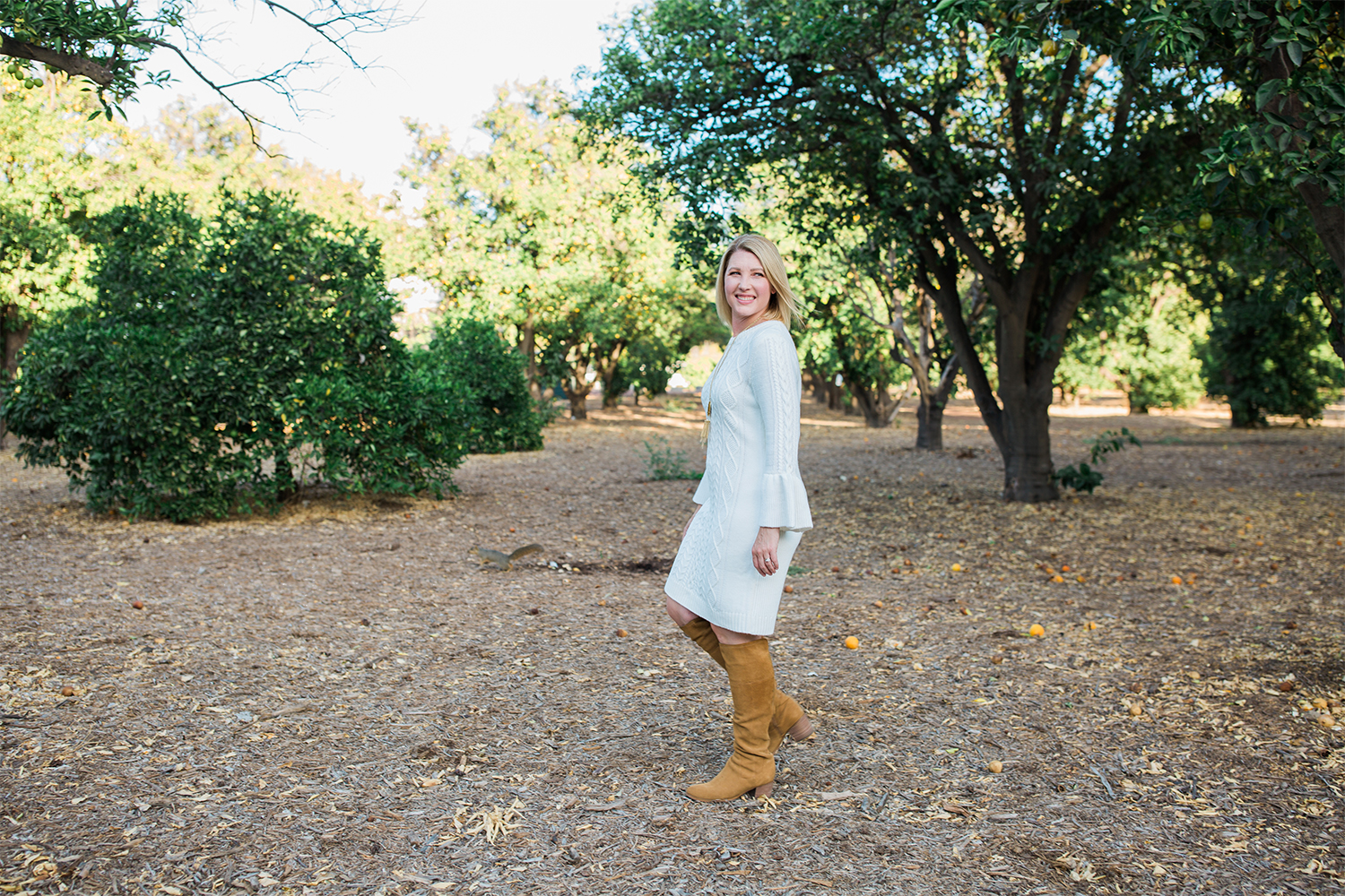 I love this white sweater dress as a casual holiday dress option!