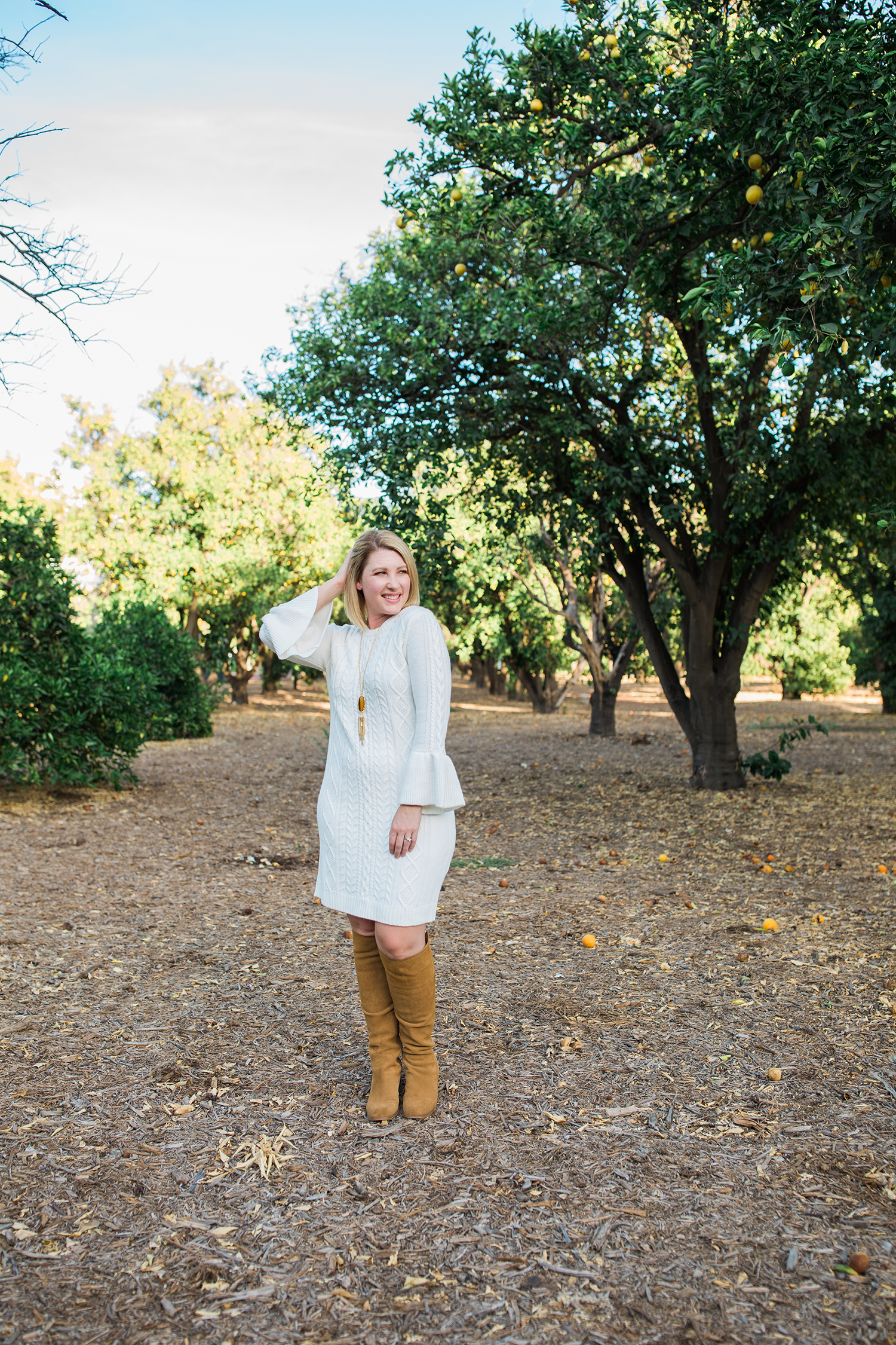 On the hunt for holiday dresses? This white sweater dress is flattering, comfortable and super versatile!