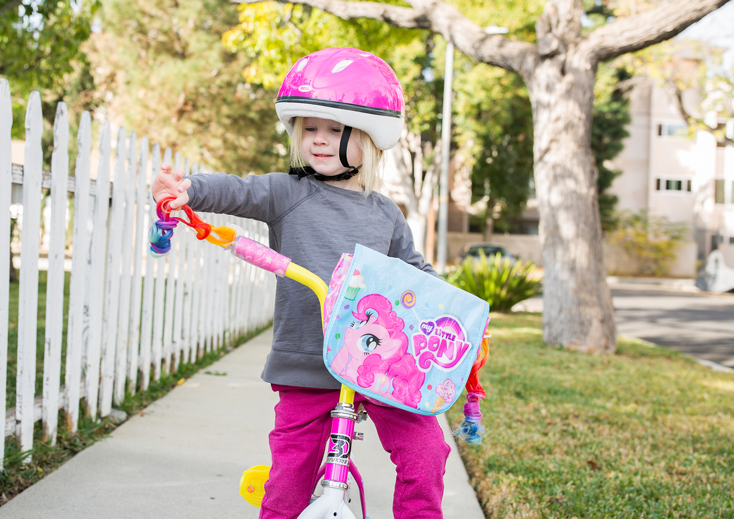 Want to know when to take off the training wheels? These 7 simple steps will help when teaching your child how to ride a bike!