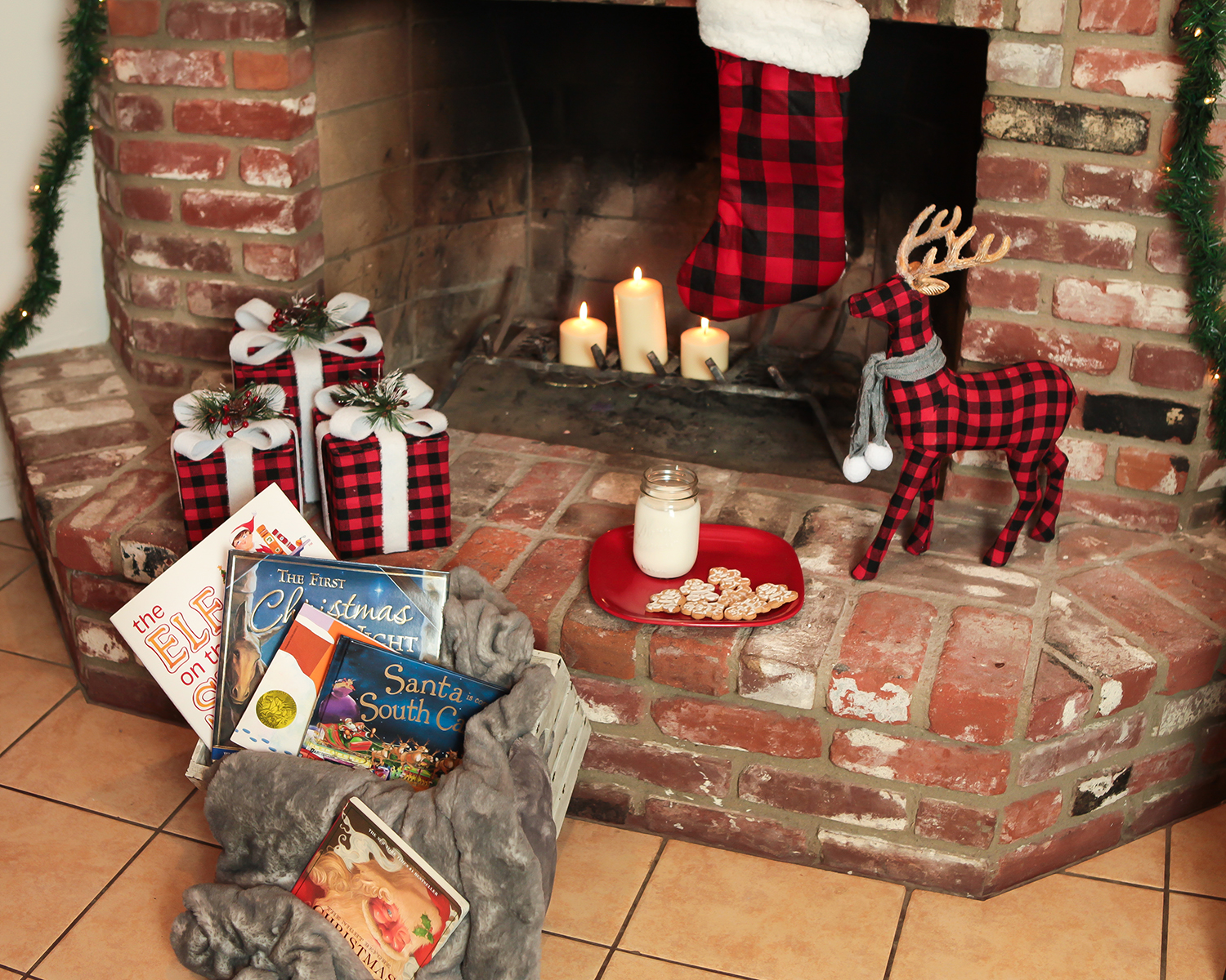 Christmas Fireplace: I love these pops of buffalo plaid and that furry blanket!