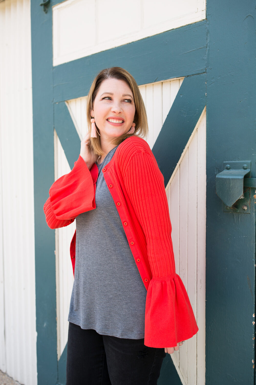 This bell sleeve red cardigan is the perfect staple piece for a spring wardrobe!