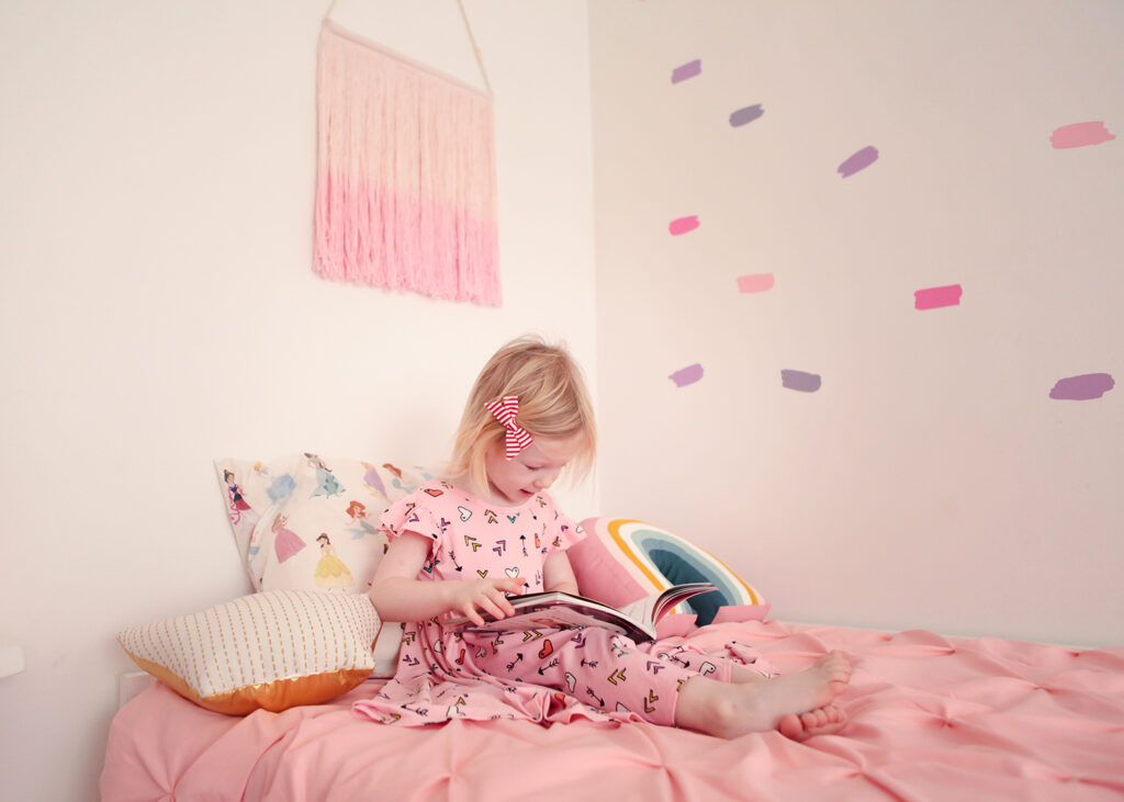 Princess Room Makeover: I love this Disney princess bedding, and that pink wall hanging? Too cute!