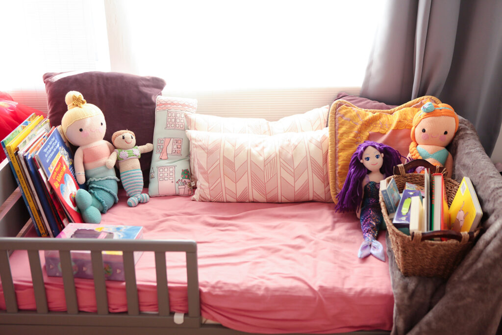 Life Hack: Use that old toddler bed as a book nook!