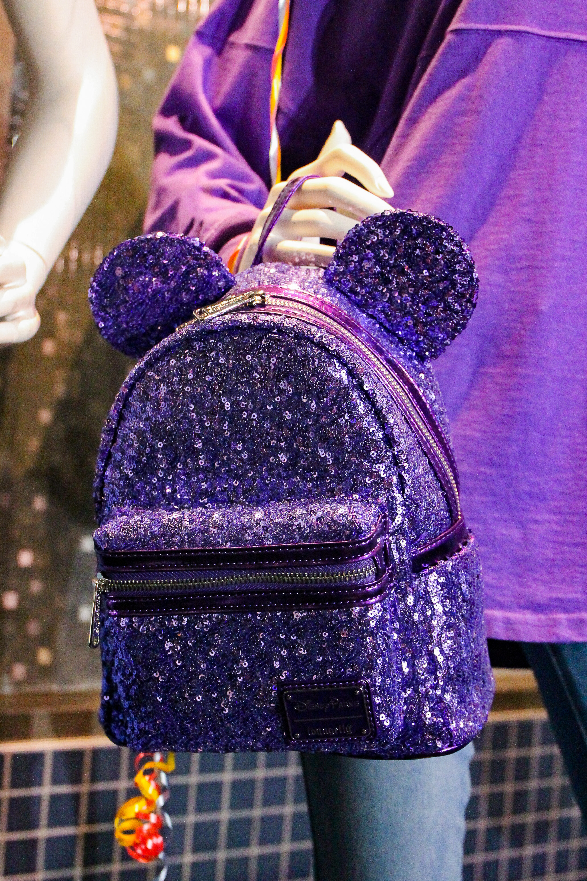 Obsessed with Disneyland merch? Get Your Ears On just kicked off and the merchandise is AMAZING! This Potion Purple backpack is the hottest item!