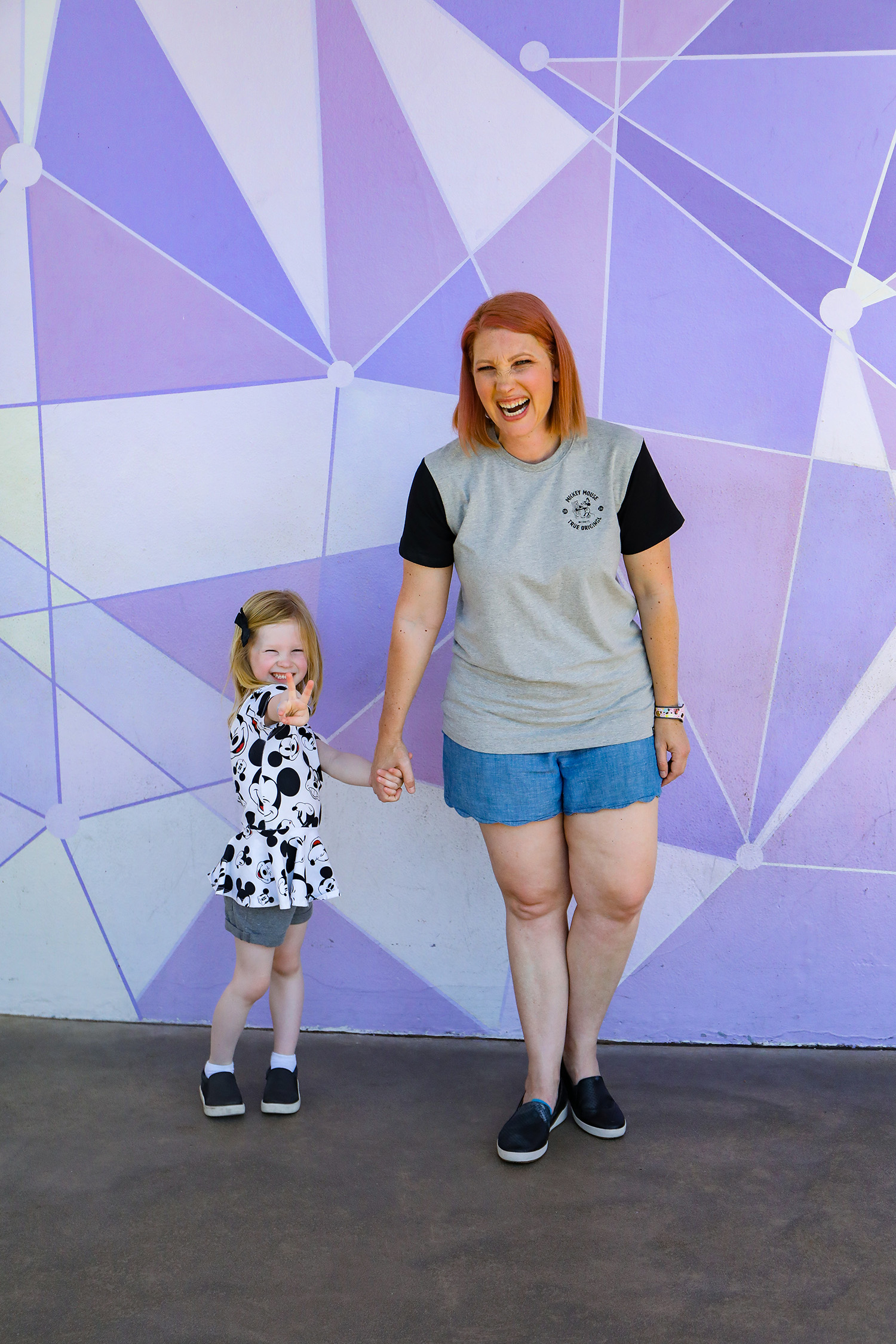 Gotta love that purple wall! Magic Kingdom is perfect for taking cute photos, and these Disney World Outfits? Mommy and me perfection!