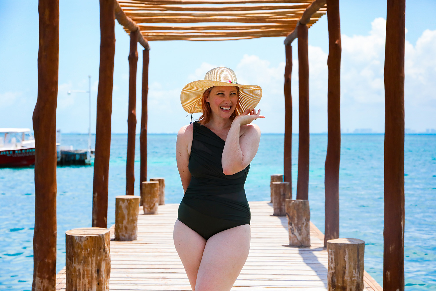 Looking for flattering swimsuits for moms? This one shoulder suit is a great option!