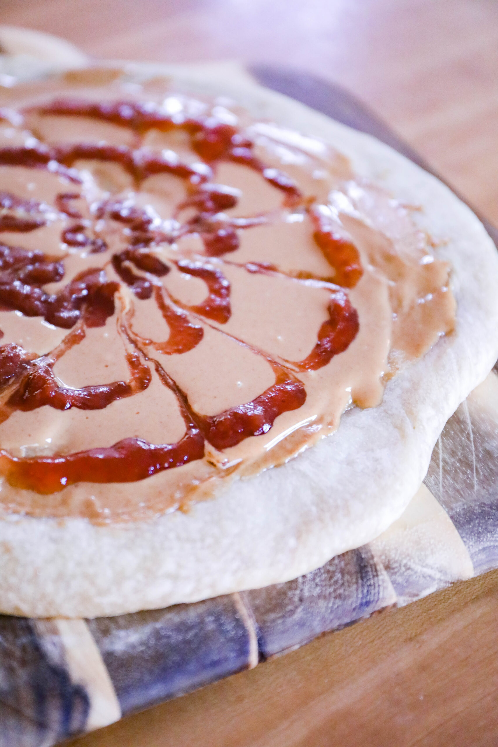 Have you had the Peanut Butter and Jelly pizza at Goofy's Kitchen? This copycat recipe is just like the real thing!