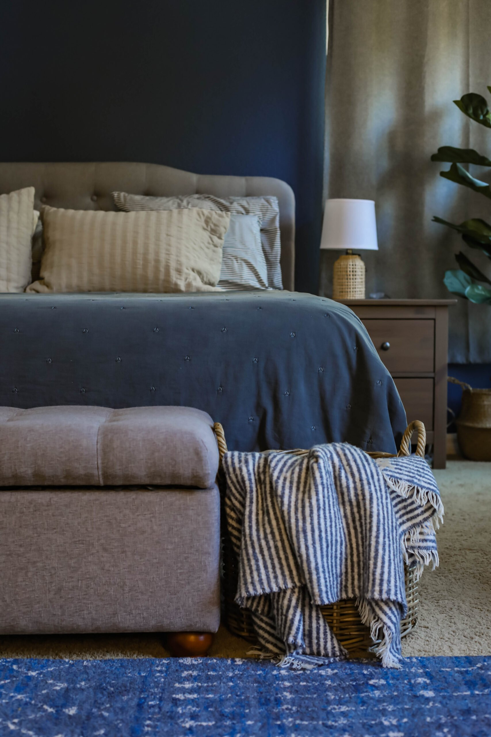 Thinking about a blue accent wall? This bedroom wall is painted with infinite deep sea by behr and it's a great example of a mature blue accent wall bedroom option (it's almost a navy accent wall, just a bit lighter!)