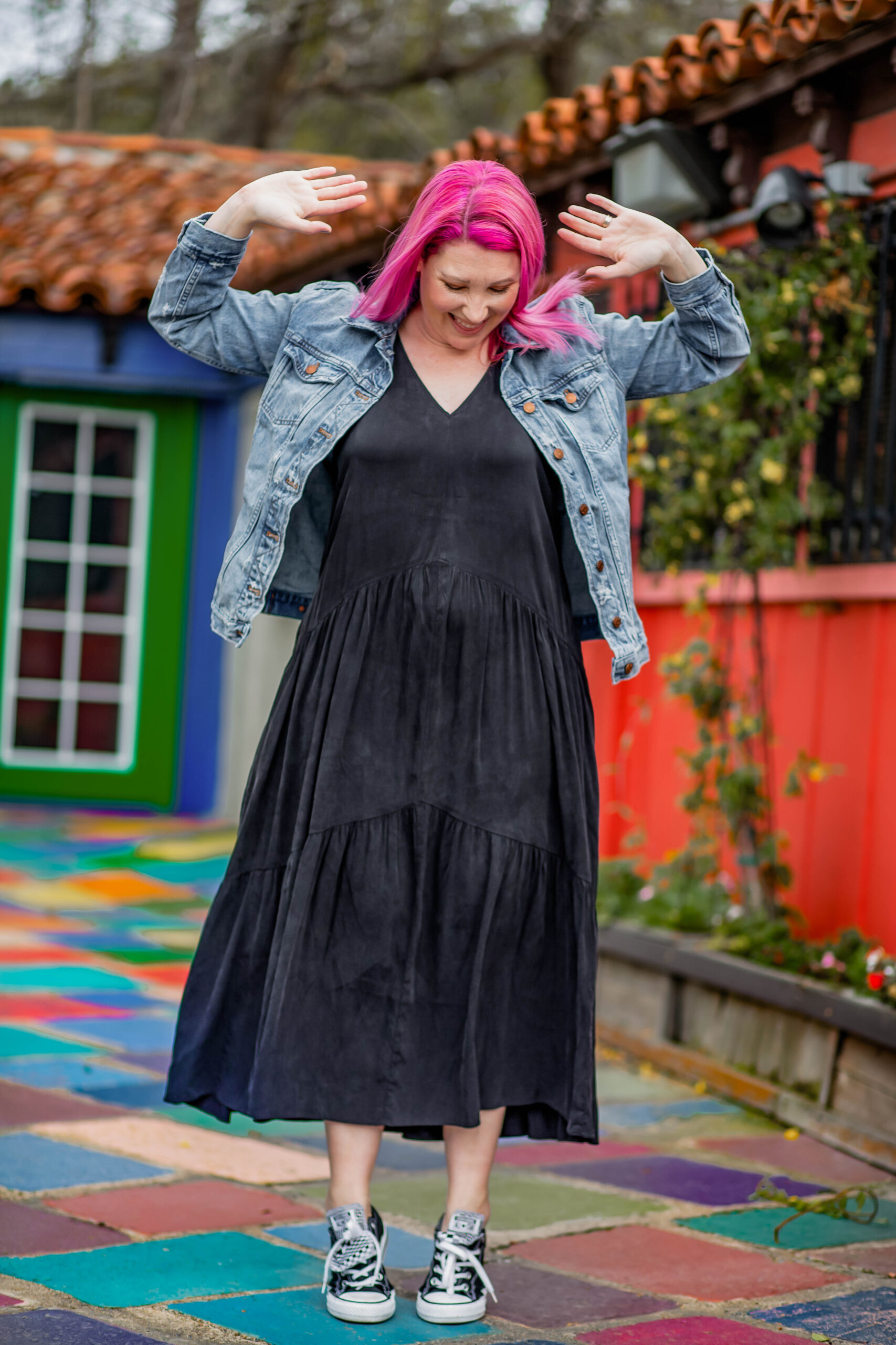 Looking for ways to style a black maxi dress? This jean jacket and converse outfit is a great casual outfit idea!