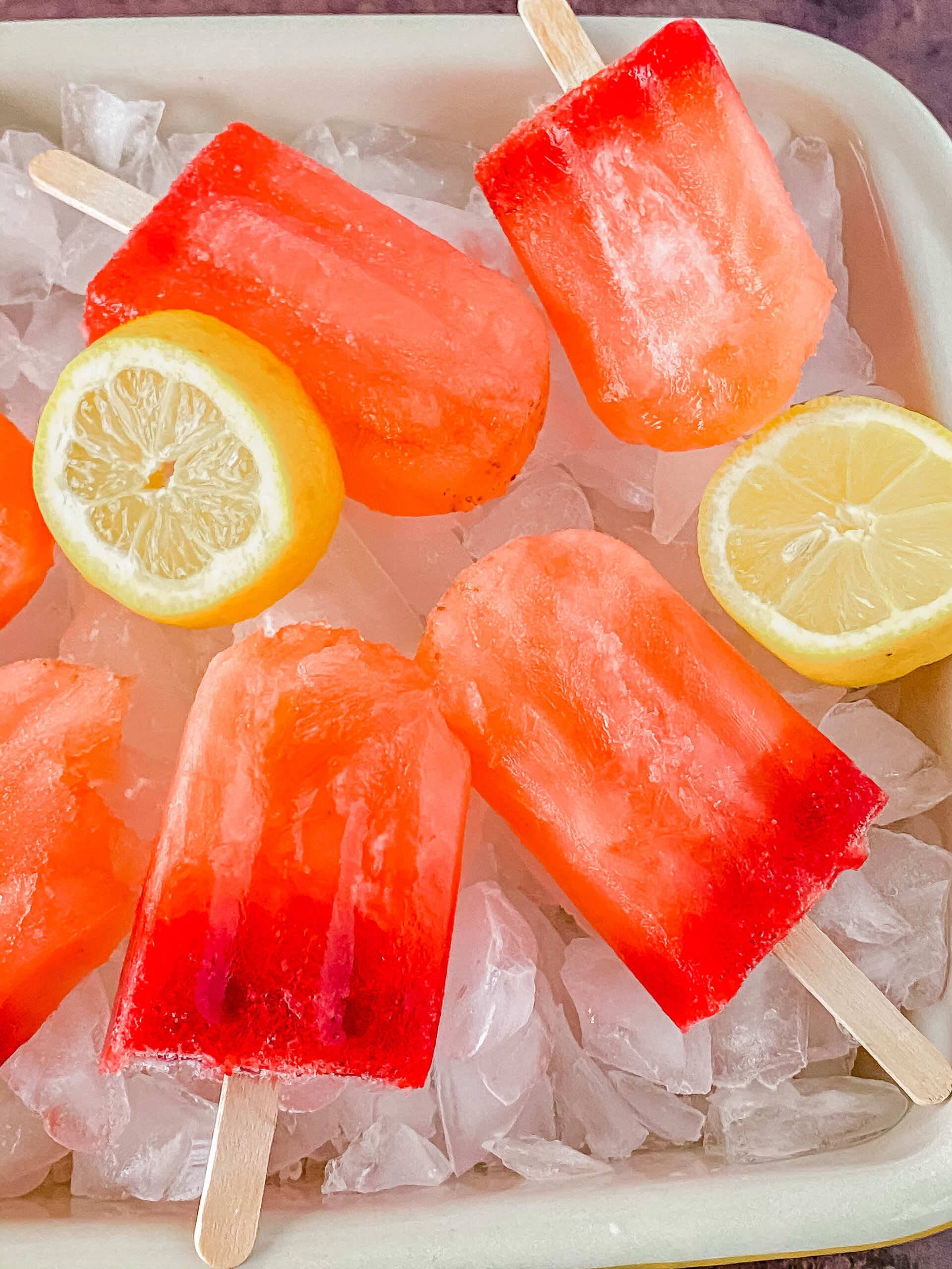 Looking for a fun and easy recipe to make this summer? These strawberry lemonade popsicles are delicious and are perfect for warm weather!